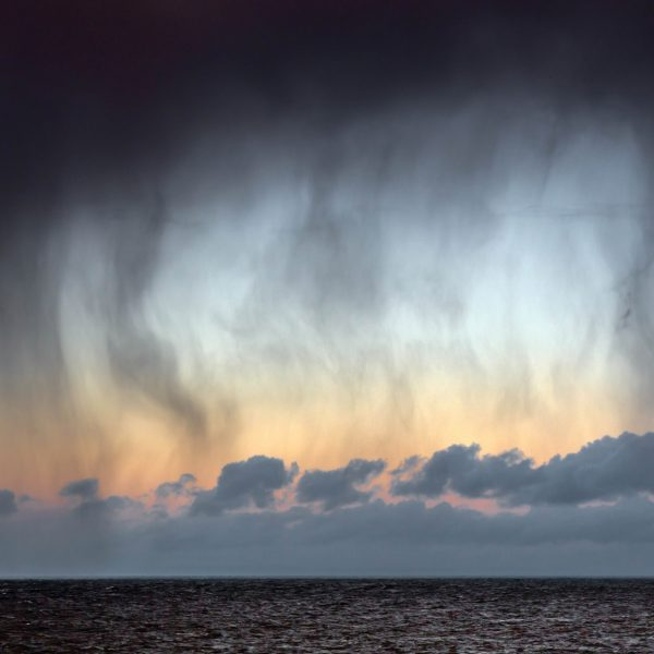 Dark clouds and rain over ocean