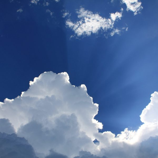 Bright white clouds with sun rays